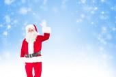 Cheerful santa claus waving — Stock Photo