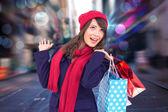 Brunette holding shopping bags — Stock Photo