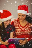 Festive mother and daughter using tablet — Stok fotoğraf