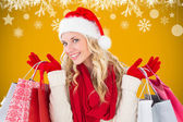 Festive blonde with shopping bags — Stock Photo