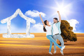 Happy casual couple cheering together — Stock Photo