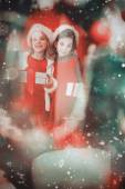 Festive little girls smiling at camera — Stock Photo