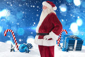 Santa Claus shows his side to camera — Stok fotoğraf