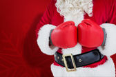 Composite image of mid section of santa with boxing gloves — Stock Photo