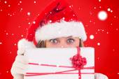 Festive blonde holding a gift — Stock Photo