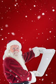 Father Christmas holds list — Stockfoto