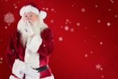 Santa asking for quiet to camera — Stock Photo