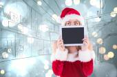 Pretty santa girl holding tablet — Stock Photo