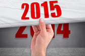 Hand pulling 2015 year — Stock Photo