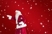 Santa pulls something with rope — Stock Photo
