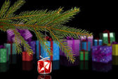 Composite image of red christmas decoration hanging from branch — Stockfoto