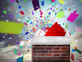 Chimney filled with gift — Stockfoto