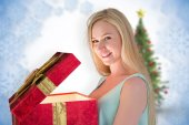 Festive blonde opening gift — Stock Photo