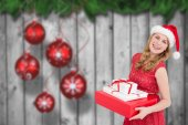 Woman holding present — Stock Photo