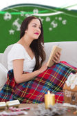 Composite image of pretty brunette reading — Stock Photo