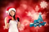 Festive brunette in boxing gloves — Stockfoto
