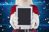 Santa presents a tablet PC — Zdjęcie stockowe