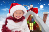 Cute little girl wearing santa hat and tinsel — Photo