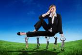 Composite image of business people supporting boss — Stock Photo