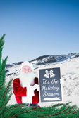 Santa claus showing blackboard — Stok fotoğraf