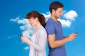 Couple both sending text messages — Stock Photo