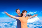 Composite image of happy couple looking upwards — Stock Photo
