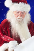 Santa writes something with feather — Stock Photo