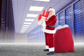 Santa claus carrying pile of gifts — Stock Photo