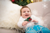 Cute baby boy on couch — Stockfoto