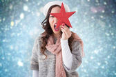 Excited brunette in winter clothes holding st — Stock Photo