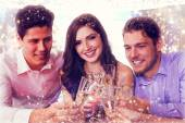 Composite image of friends toasting with champagne — Stock Photo