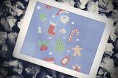 Christmas graphics against tablet pc — Stock Photo