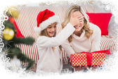 Festive mother and daughter with gift — Stockfoto