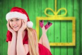Composite image of festive blonde smiling at camera — Stock Photo