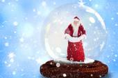 Santa holding open sack in snow globe — Foto Stock