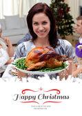 Woman showing to camera Christmas turkey — Zdjęcie stockowe
