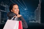 Smiling woman holding shopping bag — Stock Photo