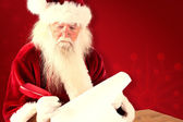 Santa writes something with a feather — Stock Photo