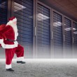 Santa carrying sack of gifts — Stock Photo #62480675