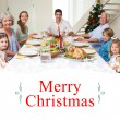 Family having christmas meal together — Stock Photo #62481365