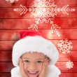 Composite image of cute little girl wearing santa hat  — Stock Photo #62481967