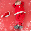 Boy napping in santa costume — Stock Photo #62482203