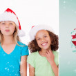 Cheerful girls with Christmas hats — Stock Photo #62483063