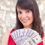 Brunette showing fan of dollars — Stock Photo #62483163