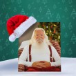 Composite image of happy santa without his jacket — Stock Photo #62483181