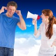 Woman shouting through a megaphone — Stock Photo #62484459