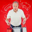 Shocked man holding shopping bags — Stock Photo #62485129