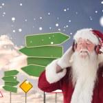 Santa Claus enjoys some music — Stock Photo #62486727