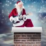 Santa Claus has fun with guitar — Stock Photo #62486913