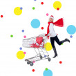 Festive blonde pushing trolley full of gifts — Stock Photo #62487523